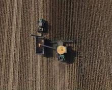 photo of a farmer from the sky looking down