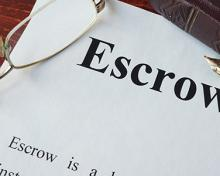 the word escrow on paper