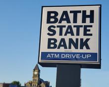 Bath State Bank sign with union county courthouse in background